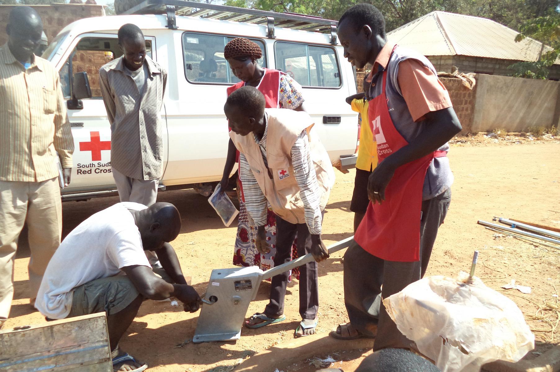 SSRC volunteers repairing a handpump
